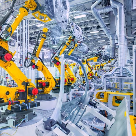 Factory floor with many robot arms