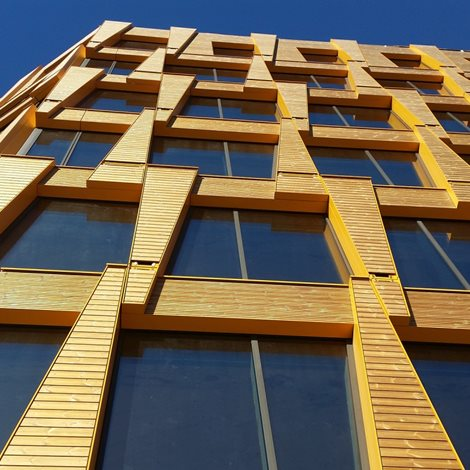 building facade with wood and glass