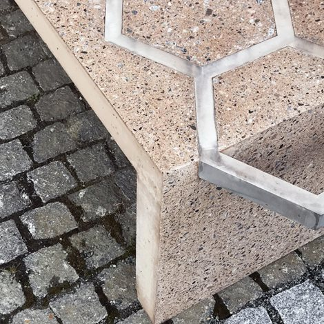Concrete bench reinforced with exposed aluminium shapes
