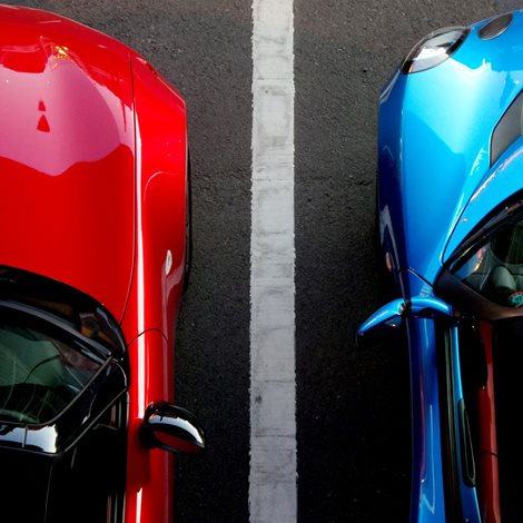 A red and blue car seen from above