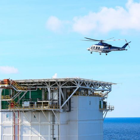 a helicopter landing on an offshore installation