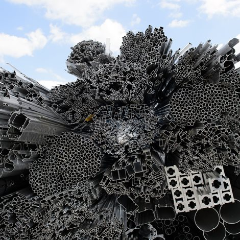 heap of aluminium rods and extruded profiles
