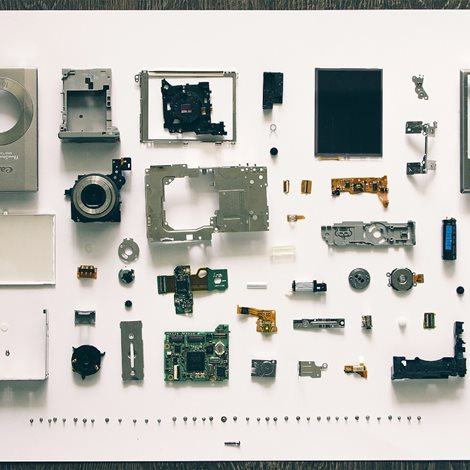 a disassembled pocket camera