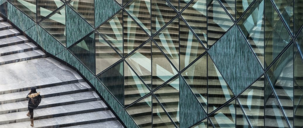 building facade with diamond shaped glass and stone panels