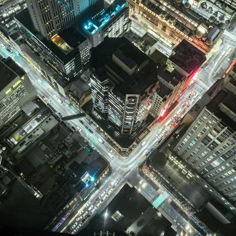 Brightly lit busy city streets at night